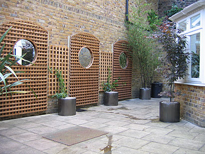budding ideas walled patio garden design
